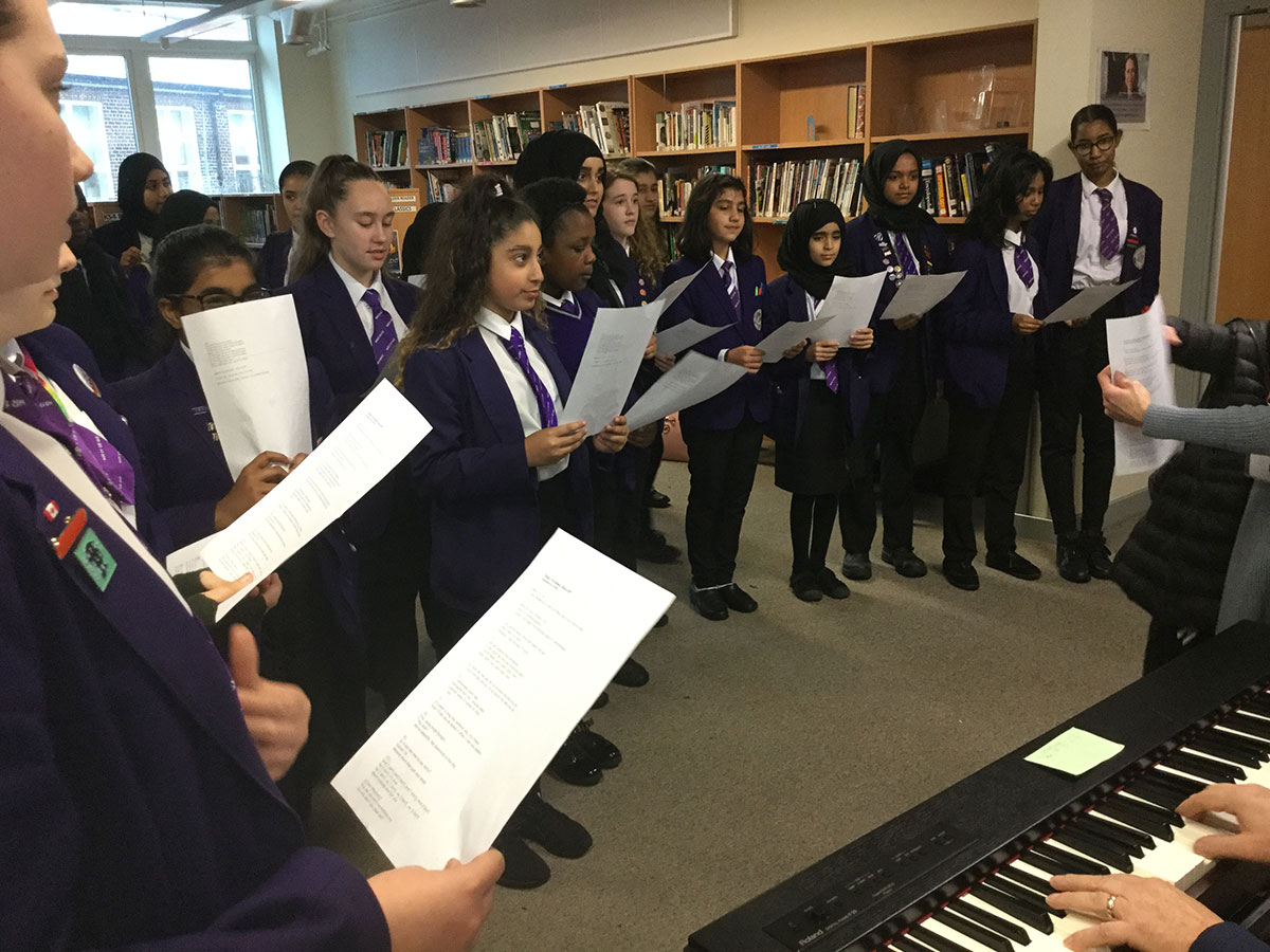 Mr O'Hara and the school choir providing entertainment in the LRC as part of National Libraries Week