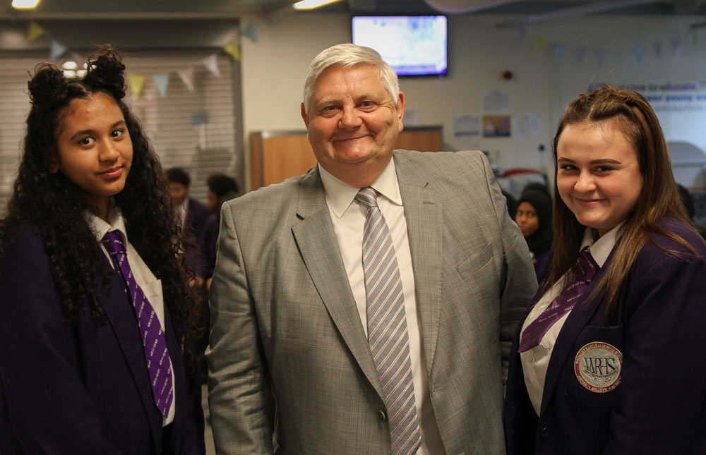 Lord Goddard (centre) with students from Whalley Range 11-18 High School in 2017