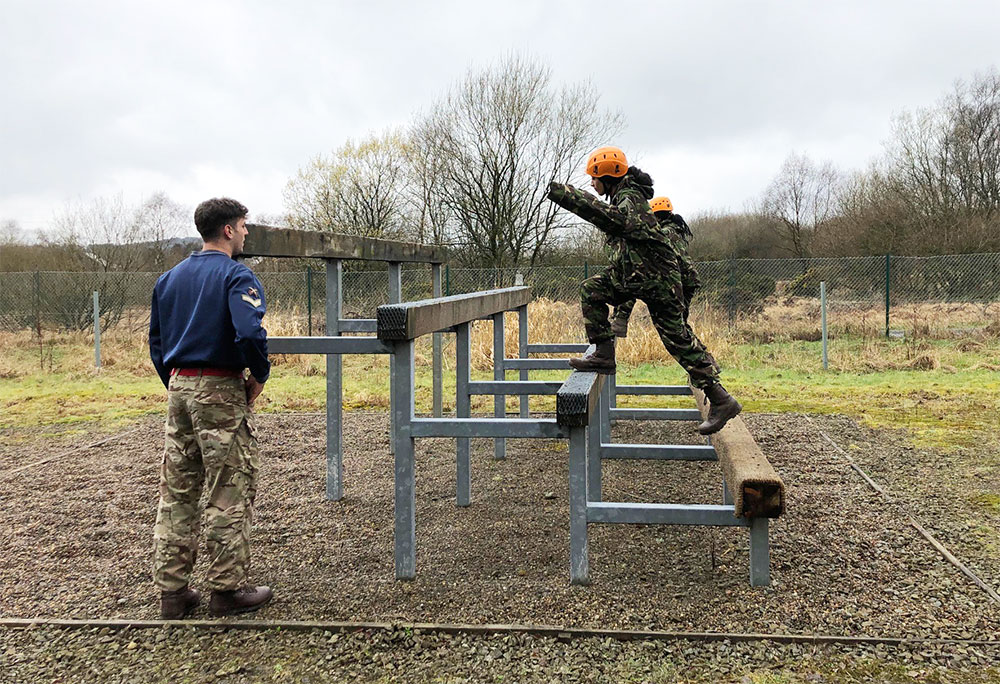 Students involved in an obstacle course during a residential trip to Holcombe Moor Army Camp in 2019